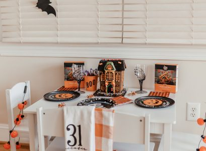 Halloween Kids Tablescape | Babies, Love, and Lattes by Jessica Linn Halloween cookies decorating kits, and halloween gingerbread house from Target. Kids Halloween pajamas